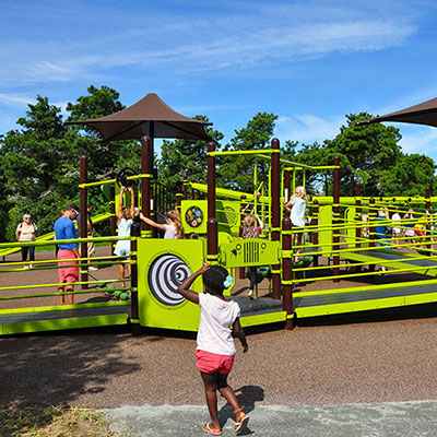 Kids playing at the maria mitchell discovery playground at hinsdale park